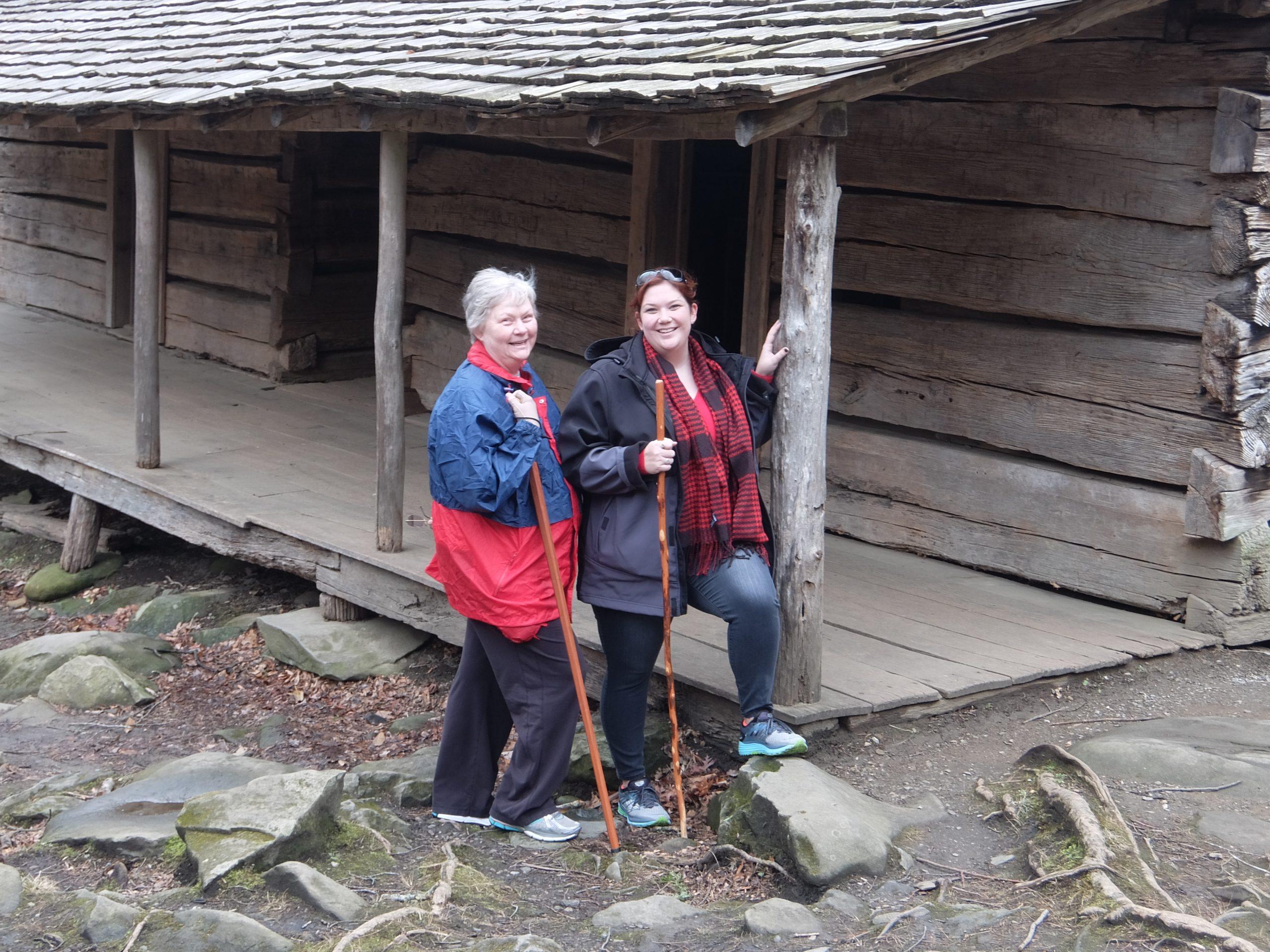 """Kathy Ogle and daughter Rachel at the Noah """"Bud"""" Ogle Cabin"""